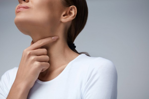 Throat Pain. Closeup Of Sick Woman With Sore Throat Feeling Bad, Suffering From Painful Swallowing. Beautiful Girl Touching Neck With Hand. Illness, Health Care And Medicine Concepts. High Resolution