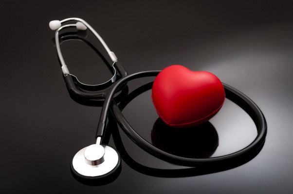 Stethoscope and heart for blood pressure check up on black background