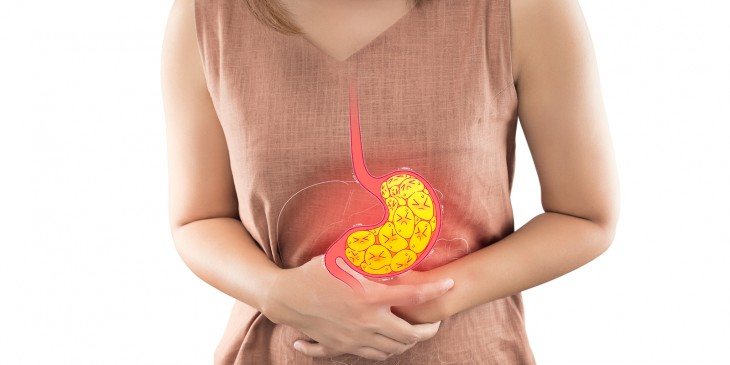Woman suffering from indigestion or gastric isolated on white background